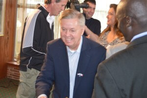 Graham shakes hands after his speech