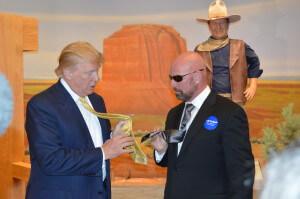 Trump compares ties while John Wayne looks on