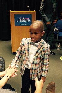 Adams' son Solomon wins the best dressed award for a campaign kick-off