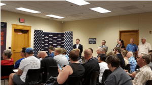 Rand Paul Stands Aside While a Campaign Aide Solicits Support with Lapel Pins