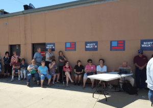 Scott Walker fans avoid the sun at his Sioux City event
