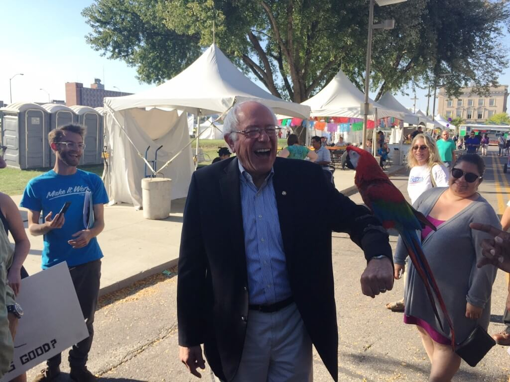 Sanders with a parrot in Des Moines, September 2015