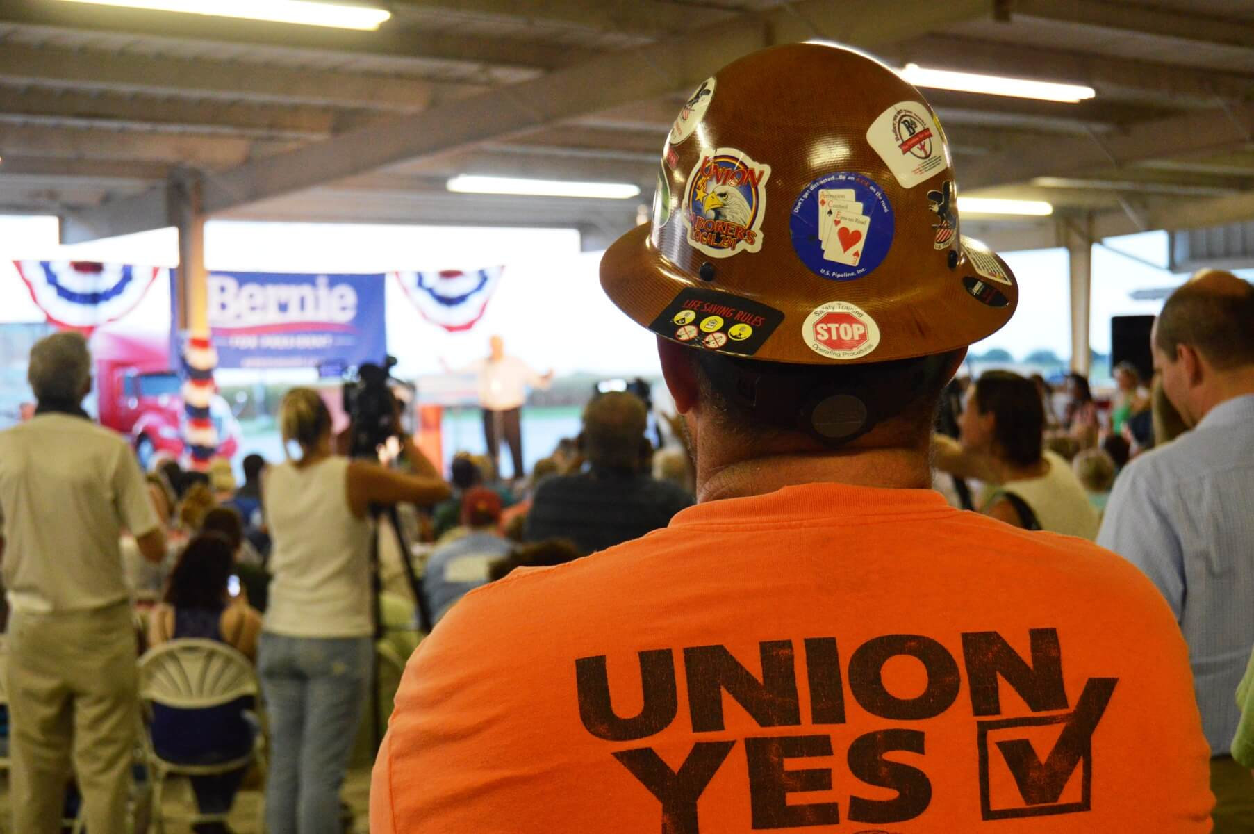 A union member listens to Sanders in August with a crowd of 500 in Burlington