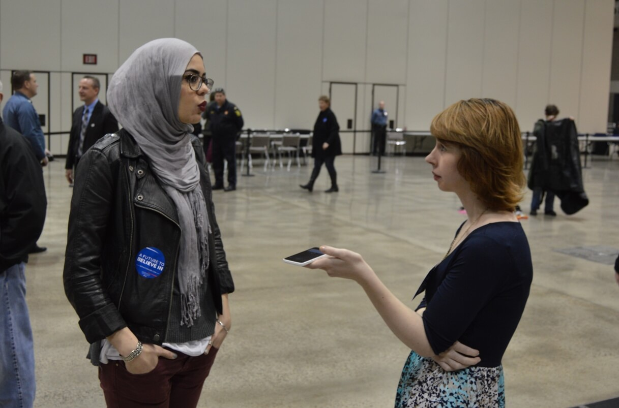 A Sanders supporter is interviewed at the Kansas City rally