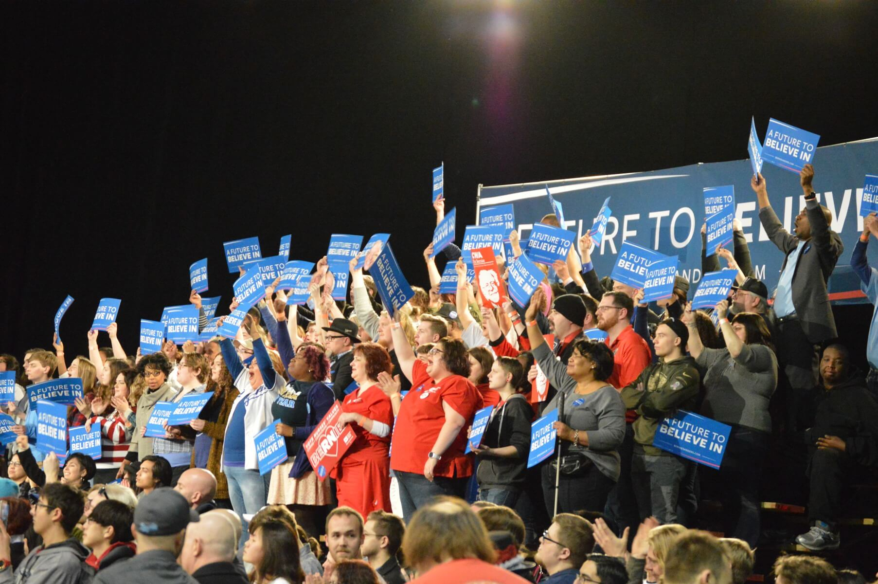 Supporters cheer at a Sanders rally in Kansas City