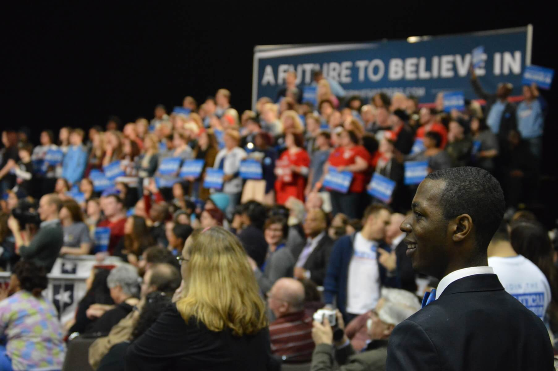 Kansas Dems ED Kerry Gooch looks out at potential new Democrats at Sanders rally