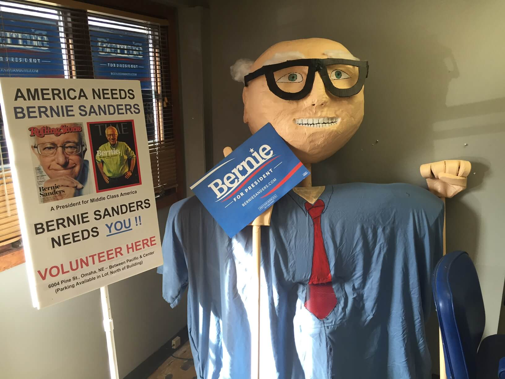 A giant Sanders puppet in their Omaha HQ