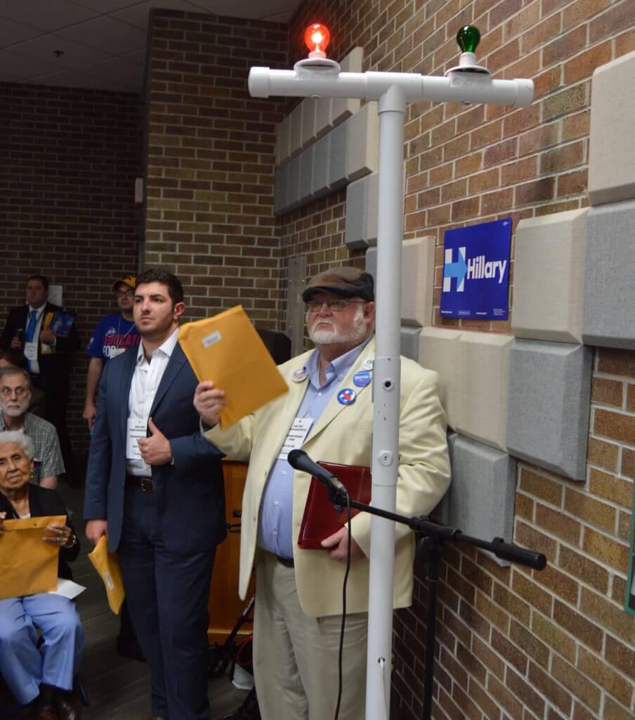 A delegate waits to speak