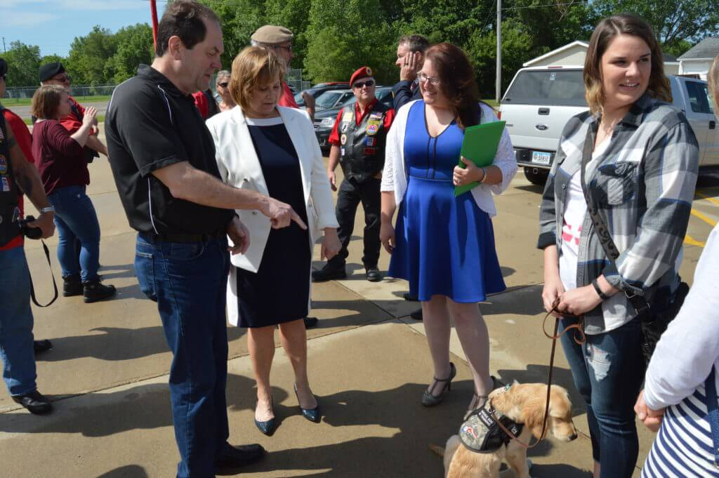 Vernon and Kressig meet a service dog in training