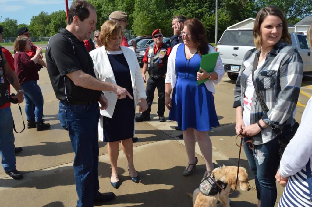 Vernon and Kressig meet a service dog in training