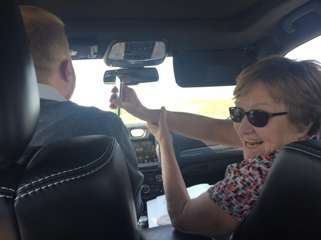 Judge hands the phone to driver Oglesbee to talk with an activist