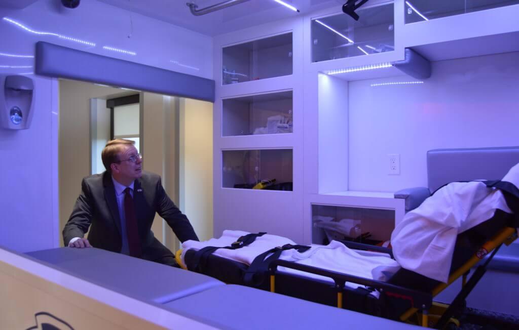 Hogg takes a look inside a ambulance simulator