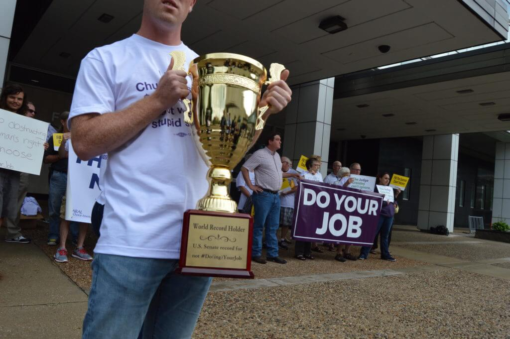 Rally-goers made a mock trophy for Grassley's new record