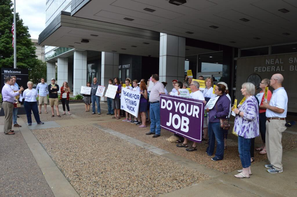 Iowans protested outside of Grassley's six Iowa offices on Tuesday